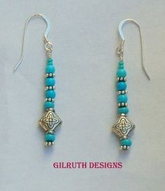 Turquoise stone beads and smaller seed bead accents; sterling silver daisy spacers and ear wires. These earrings are fun to wear and sure to bring many compliments.