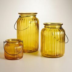 add these ribbed-glass lantern candle holders to any mantel to bring in color and height differences!  Deciture.com