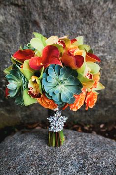 Orange and Green wedding bouquert with orchids, lilies and succulent accent flower Bahia Resort wedding // San Diego Wedding