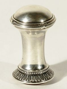 A SILVER FABERGE HARDSTONE DESK SEAL, ANDERS NEVALAINEN, ST. PETERSBURG, 1899-1908, the hardstone engraved with initials 'HJ', with a leaf and ribbon-tied border, height: 5.5 cm (2 1/8 in.), workmaster`s mark 'A.N', '88' standard,