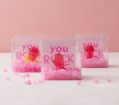 The Favors - Bridal Shower When it comes to the takeaways, make sure they're just as lively and fun as the party. Start with clear plastic boxes and pop in a sheet of patterned paper, which you can dress up or personalize with stickers. Fill these punchy containers with hot pink rock candy and ring pops.
