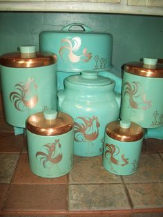 Vintage Ransburg turquoise or aqua canister set, cookie jar, and cake carrier with rooster motif. Vintage Canister Sets, Kitchen Canister Sets, Kitchen Jars, Vintage Kitchenware, Vintage Tins, Vintage Dishes, Kitchen Ideas, Diner Kitchen, Retro Kitchens