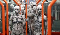 Models turned into 'humanoid' robots pose on a train at Waterloo station for the launch of new drama Westworld
