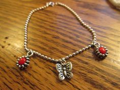Vintage Lovely .44ctw Genuine Red Coral Flowers & Vintage Butterfly Charm 925 Sterling Silver Bracelet 7.5 Inches, Wt. 5.5 Grams