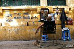 Street barber, doing what all barbers must do at one time or another...waiting for the next customer...~ Vietnam