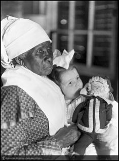 African American woman and child holding doll, South Carolina, 1905