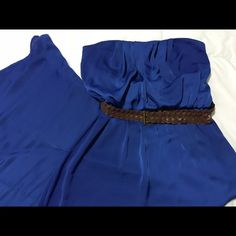 Gorgeous royal blue dress Long strapless dress in a gorgeous shade of blue. Dress includes brown belt. Perfect for a night out or holiday parties. City Triangles Dresses
