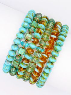 Six strands of Turquoise Picasso carved beads and turquoise rondell stretch bracelets