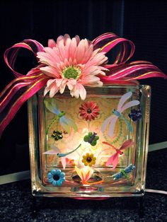 """""""Dragonflies and Blooms"""" - lighted glass block.  I made this one for a co-worker who loves dragonflies...I do too!  Dragonflies, flowers, background scrapbook paper are from Michael's and all other supplies from Hobby Lobby."""