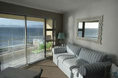 Whale Cove, also known as 'Hemel se (Heavens Veranda is an upmarket luxury Apartment situated on the cliffs of De Kelders, with the most stunning views of the Ocean. Luxury Apartments, Furniture, Apartment, Home Decor, Views, Room Divider, Stunning View
