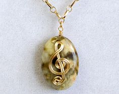 Golden Wire Wrapped Treble Clef on Jade by EclecticSkeptic on Etsy, $18.00