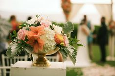 Tangerine colored flowers for a beautiful tropical outdoor wedding in Hawaii - Anna Kim Photography