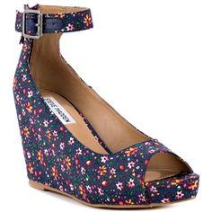 Leave it to the Lesliee to make you look good with every step. This Steve Madden style features a floral print upper with an adjustable ankle strap and peep toe. Last but not least is a 4 inch wedge and inch platform for a comfy wear all day. Steve Madden Style, Steve Madden Shoes, Walk This Way, Carrie Bradshaw, Ankle Strap Heels, Me Too Shoes, Peep Toe, Floral Prints, Wedges