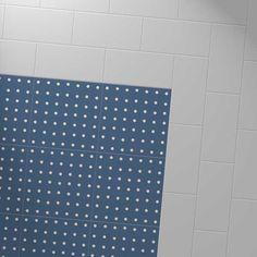 Harvey Maria Little Bricks luxury vinyl tiles in Steel grey, creating a border around the Cath Kidston Spot Prussian Blue floor.