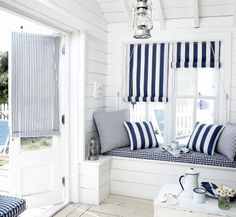 Cute cottage window nook decoratde with fun patterns and matching colors