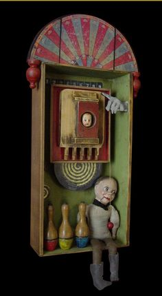 "Hit The Target 39""h x 18""w x 7.5""d Mixed media assemblage - Ventriloquist's doll, toy bowling pins, kitchen cutting board"