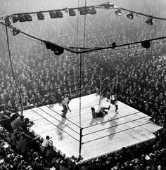 Joe Louis lies on the canvas at the original Madison Square Garden in New York after being floored by contender Jersey Joe Walcott in a December 1947 title match.