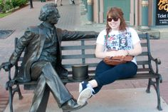 UPEI education student Kaitlin Chisolm takes a break from shopping in Charlottetown on Sunday to enjoy the record-breaking heat with Sir John A. Macdonald. Ryan Melanson photo.