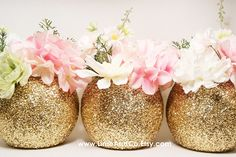 Golden globe vases are a pretty choice for your floral arrangements, whether your table settings are rustic or elegant.