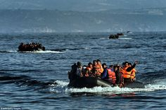 Influx: Meanwhile, a procession of rubber dinghies crammed with migrants continued to arri...