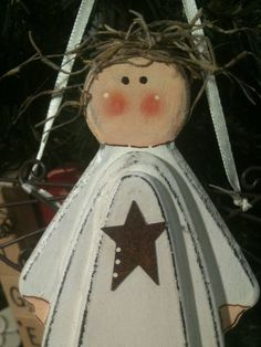Primitive Angel with Rusty star