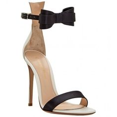 Gianvito Rossi black calf leather bow buckle sandals featuring a buckled strap with a bow on the front, a white ankle panel and a high stiletto heel. Made in I…