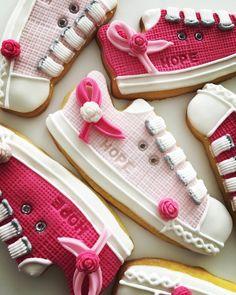 Lorena Rodriguez. Cancer awareness cookies . Tennis shoes cookies.