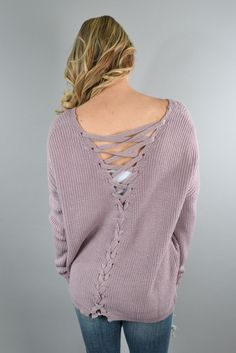 A gorgeous purple sweater with a lace up back. Fit: True to size w/a looser fit. Material: 55% Cotton 45% Acrylic Model Stats: Morgan is 5'5'' a size 0 wearing a small. Measurements: Small/Medium: Bus