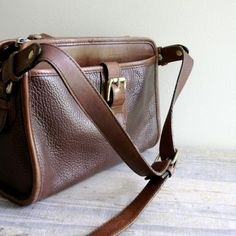 I will always pick brown leather over black.  Vintage Leather Satchel