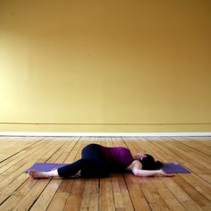 """Right before taking rest, increase side-to-side spinal flexibility with this reclined twist:  Lie on your back and wrap your left toes around the back of your right ankle, just like in Eagle Pose. Extend your arms out in cactus position with your elbows at right angles, palms facing up. Slowly lower both knees to the left. Rest them on the ground and turn your head to the right. Hold here for at least five breaths, feeling your spine lengthen and twist. You may even hear some """"cracks."""" Use…"""