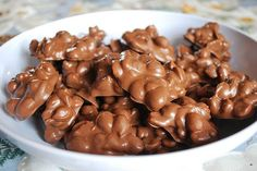 Nuts and chocolate are the only ingredients needed for this crock pot candy. Divide batches into gift bags for the ultimate fall giveaways. Chocolate Candy Recipes, Almond Bark, Trisha Yearwood, Chocolate Peanuts, Absolument, Granola, 5 Minute Desserts, 4 Quart Slow Cooker, Cupcake Liners