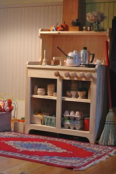 "Beautiful - just thinking that if I see the right ""piece"" available at a yard sale, I could redo my kitchen centre. I like the wooden dishes in the cabinet (glass is obviously removed - but it is still ""open) and the wooden eggs. I've seen them somewhere....where have I seen these?"