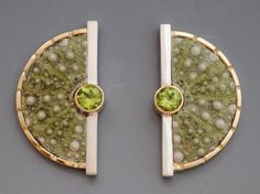 sea urchins from Maine set in 14ky gold and sterling silver with peridots by Barbara Umbel