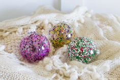 Such a fun, colorful christmas ornament idea! Easy melted crayon art DIY ornaments! from heatherednest.com