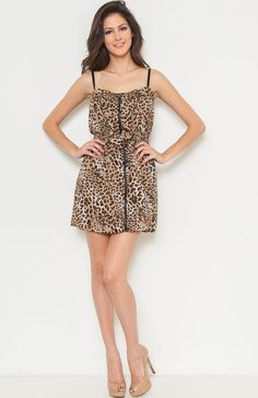 Adjustable spaghetti strap sweetheart cheetah print dress featuring elastic waist, front zip up, and ruffle front. Throw on a cardigan over for a fabulous look.Price Per Piece $9.95