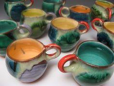 "Mugs - 2013 H 4"" L 5"" D 3.5"" Wheel –thrown and altered Nova Scotia earthenware with slip and glazes. Joan Bruneau - Studio Potter - Lunenburg Nova Scotia - Work"
