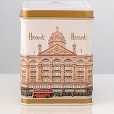 Harrods Breakfast Tea tin .. decorated with image of the London department store with red doubledecker bus on the street, UK