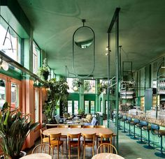 A tropical addition to the restaurant scene in Amsterdam East, Bar Botanique, designed by Studio Modijefsky, brings a fresh and green interior to the former local Dutch café, De Ponteneur.