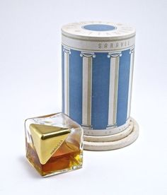 1939 Saravel Morocco perfume bottle, clear glass, metal cap and screw cap, molded labels, box (interior wear). 1 3/4 in.