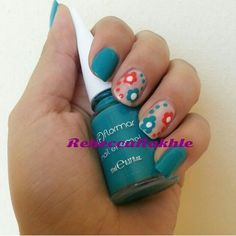 """#tbt This design was posted June 22 2014. Turquoise and Orange Flower Nails using Flormar #429 in """"Cyan"""""""