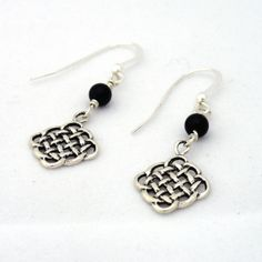 Hey, I found this really awesome Etsy listing at http://www.etsy.com/listing/155846509/celtic-knot-earrings-black-onyx-earrings