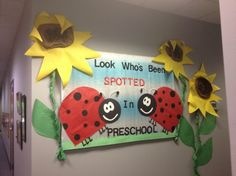 """Look What's Been """"Spotted"""" in the Library with book covers, like the 3-D sunflower stems"""