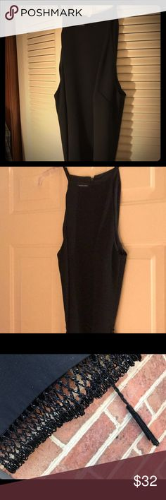 Donna Morgan Black Mini Dress Fully lined black mini dress has thin straps and full zipper back. Darts accentuate above waist and beaded matching belt compliments any shape. Bottom hem has seed-beaded scalloped trim to match belt. Like new. Donna Morgan Dresses Mini