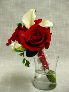 Dainty bridesmaid bouquet of red roses, white miniature calla lilies and white freesia