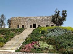 The greenest buildings of 2011 - CNN.com Overlooking Basbina in northern Lebanon, this winery combines a restored 400-year-old feudal house with a modern-built, green-skinned (walls or roof of any building that have green capability e.g. they could have plants growing in them) structure. Designed by Raed Abillama Architects, its cellar spaces are buried within the ground as a thermal sponge, creating the needed equilibrium of temperature and humidity. Award: Green Good Design 2011