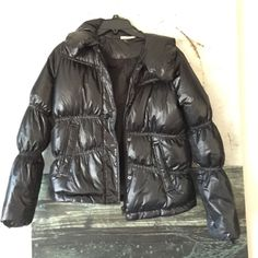 DKNY Jeans Puffer Bomber Jacket Sophistication and puffiness don't typically belong in the same sentence, but DKNY's design is pillow-soft and sleek. Exterior is all-poly; fill is 55 percent down/45 percent waterfowl feathers. Machine wash cold. DKNY Jackets & Coats Puffers