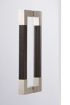 "DH403/BB - Exquisite leather door handles. Leather bound handles with 1"" square body make for an easy grip surface. Classic look in a stunningly modern design. Sold as a set of 2. Back to back mounting hardware included. Colors: Nickel with Black, Chestnut Brown or Chocolate Brown leather."