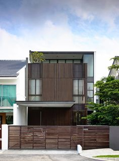 Built by HYLA Architects in Singapore, Singapore with date 2013. Images by Derek Swalwell. Eng Kong Garden is a typical 3-storey semi-detached house in Singaporewith a site area of about 300sqm. A timber-clad...