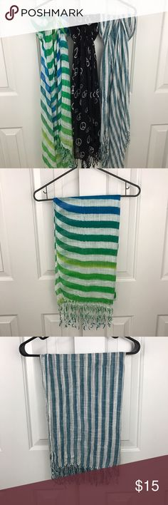 3 Lightweight Scarf Value Pack The is a fantastic deal! 1 scarf is blue/green ombré stripes, 1 is blue and white stripes and the last is black with white piece signs. All scarfs have slight wear 💙💚💛 Accessories Scarves & Wraps