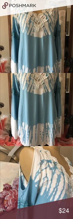 """T Party Tie Die bell sleeve Tunic NWT size Large T Party size large new with tag blue and white cut out shoulder bell sleeve Tunic top. Absolutely adorable. 💯 percent rayon. Measures 21"""" arm pit to arm pit, about 30"""" shoulder to hem. About 20 1/4"""" across bust area lying flat, about 27"""" across the bottom. Lace crochet like around neck embellishment . Adorable. T Party Fashion Tops Blouses"""